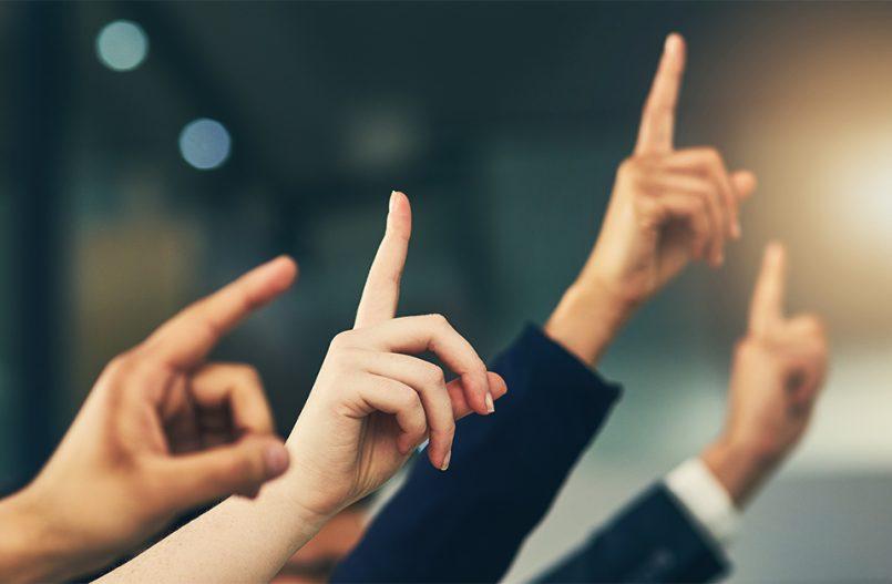 Employees' raised hands