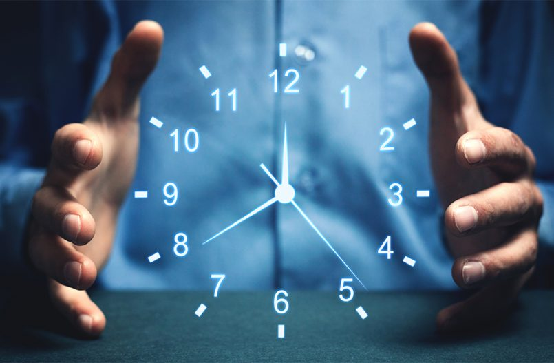 Hands trying to hold a clock