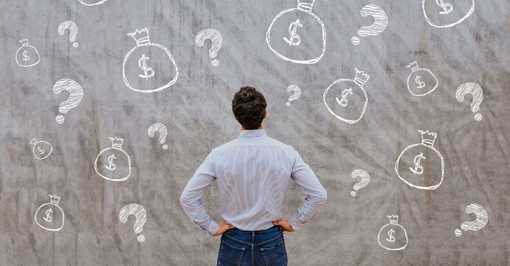 Man looking at dollar signs and question marks
