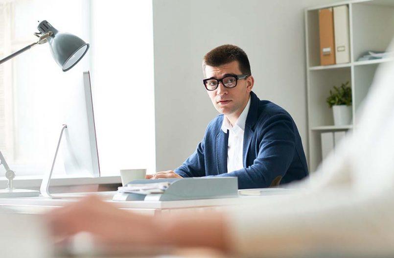 Nervous employee sitting at desk